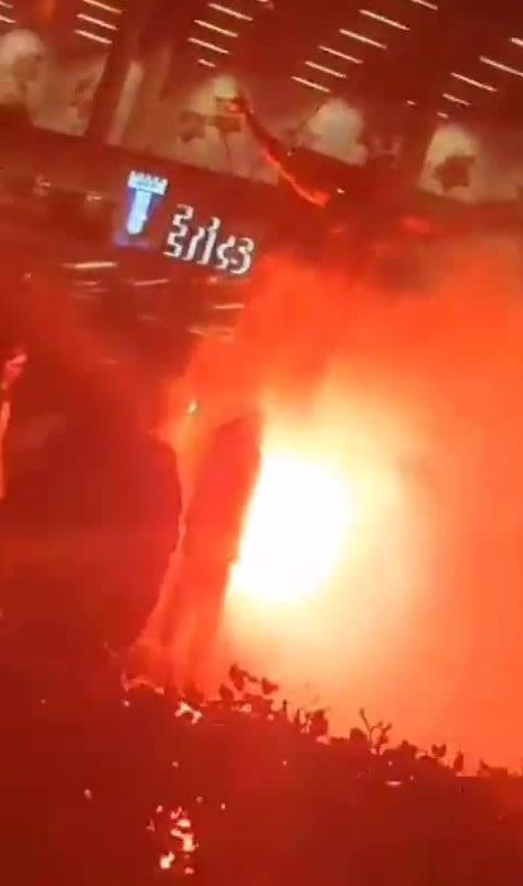 Fans watch on as the Ibrahimovic statue burns